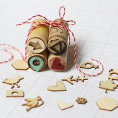 Create your own stamps using wine corks and mini wooden shapes.