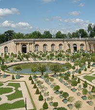 MANSART'S WORK  Overlooked by the Château, the Orangerie with its wide space, high trees and pure lines is one of the crowning achievements of Jules Hardouin-Mansart which best shows his talent as a great architect. Some of the orange trees from Portugal, Spain and Italy, and lemon and pomegranate trees are over 200 years old. They are kept indoors here in winter before being spread during the summer on its flowerbed.