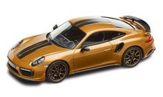 The+911+Turbo+S+Exclusive+Series+with+its+black+and+golden+yellow+interior+even+cuts+a+fine+figure+at+a+scale+of+1:43+inside+a+display+case.++The+high-quality+collector's+model+made+of+resin+is...