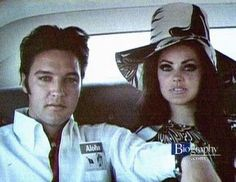 Priscilla in 60s makeup and hat. LOve it.