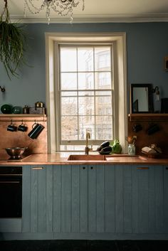 The kitchen has countertops made of a single sheet of copper (so no surface seams), with an integrated copper sink. The copper has a matte finish and a lightly pre-applied finish for patina.
