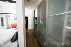 Modern Atlanta Home Tour 2014: Custer House. 1800 sq. ft. 3 bedrooms. TaC Studios Architect. Walk around master bedroom closet behind the bed wall