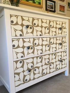 Bryn Jones, Australia - Thanks to our very clever purchase of the Loki wallpaper, our bedroom furniture renovation project (bedside cabinets & chest of drawers) turned out better than expected. Our boring black set has a new life thanks to Wallpaper From The 70's.