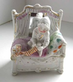 Antique Conta Boehme porcelain Fairing child pulling on sock figurine