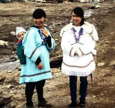 Inuit mother's wearing amauti. they are also called parkas or anorak.