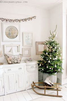 Hello everyone! So here is our little Christmas tree in the living room. It's a Fraser Fir, and it smells absolutely divine. We fell in love with it's quirky shape…