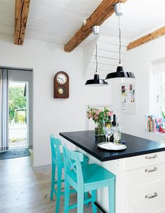 I love this black and white kitchen paired with turquoise bar stools chairs