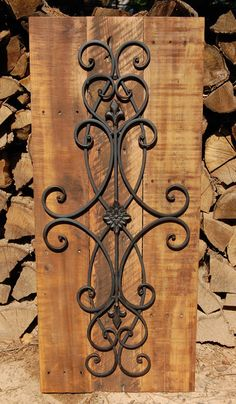 This Decorative Wall Art has a metal grill with traditional Fleur de lis design mixed with elegant scrolls mounted on reclaimed pallet wood...Hang it vertical or horizontal in your Living Room, Kitchen, or Bedroom...You'll LOVE this hanging in just about any room of your home.    We would be happy to customize yours with a Shabby Chic distressed painted finish or a Rustic stained finish like this one...YOU CHOOSE!!! Take a minute and check out a popular item in our shop...Looney Bins…