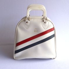This little bag is being featured in Olympic Games treasuries. It's a little star! VINTAGE BOWLING BAG/ Red White and Blue. $28.00, via Etsy.