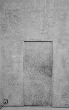 Beautiful concrete door. Love how the door blends in with the walls, almost making it a secret door. Also like the detail it does not have a door handle.