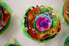 Fabric flower brooches...or barrettes.