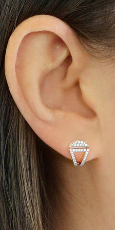 Take a break from your usual studs with this eye-catching pair of cutout huggies. #diamonds #earrings #danarebecca