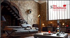 My ideal living place.  I love exposed brick work.  Roche Bobois.