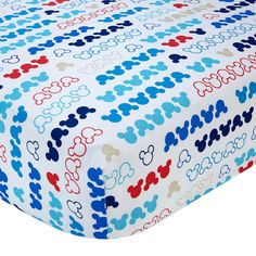 """Disney Baby - Mickey Mouse - My Pal Crib Sheet. Settle your baby into sweet slumber atop this adorable pattern of Mickey's all-over iconic silhouette print in bold blues, vibrant reds, and crisp whites. Fitted crib sheet fits a standard size crib mattress 28"""" x 52"""". 100% Cotton fabric. Coordinates with the full line of Disney Baby My Pal nursery bedding and décor."""