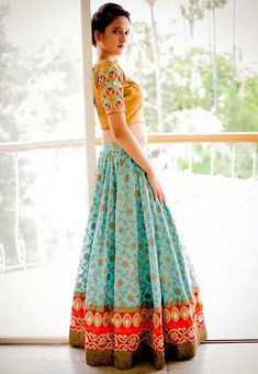Loving this colour combination! Light blue, yellow and red all in one gorgeous lehenga #indian #wedding