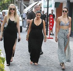Kim and Khloé each opted for an understated black maxi but amped up their looks with jewels. Kendall styled her Zimmermann bikini as a top and paired it with a long slit skirt from the same label — all the better to show off her Stuart Weitzman gladiators.