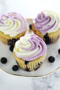 Swirled Lemon Blueberry Cupcakes are perfectly tender and moist with tons of fresh lemon and blueberry flavors, plus an easy swirled buttercream for a gourmet look that will impress everyone!
