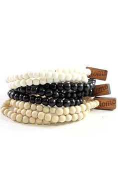 Wrap bracelet bundle with black, natural, and white 6mm beads.    Stretchy to fit most wrists.