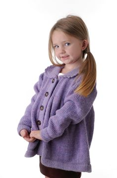 Painter's Smock Cardigan, Lilac. Medium weight 100% alpaca cadigan sweater. Hand made in Peru. Sizes: Small, 2 to 3 years; Medium, 4 to 5 years; Large, 6 to 6x; X-Large, 7 to 8 years. Colors: Robin, Ruby, Lilac shown.