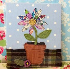 applique flower from bustle and sew. she has some other cute things like this.