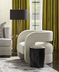 MG+BW: Kirby Chair - 70s-inspired sculptural accent chair is ultra-comfortable and substantial, in both form and presence. Fully upholstered style features a cantilevered floating seat and curved barrel-back. Perfect in pairs, or solo as an imaginative conversation piece.