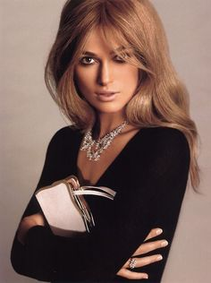 Keira / retro '60's style. Black sweater & Beautiful bling! Knockout hair!!
