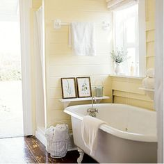 sunny soak - love the wall color Yellow Bathrooms, Clawfoot Bathtub, Bathroom Wall, Corner Bathtub
