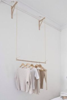 tiny house storage idea: use two brackets to hang a dowel rod and your clothing. great DIY for a home without a closet. tiny house storage idea: use two brackets to hang a dowel rod and your clothing. great DIY for a home without a closet. Tiny House Storage, Wall Storage, Bedroom Storage, Diy Storage, Lumber Storage, Basement Storage, Laundry Storage, Smart Storage, Cupboard Storage