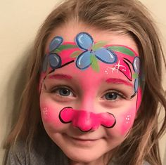 Poppy from 'Trolls' is a fun, cheery Halloween costume for fans of the Dreamworks film. We can't get over her pink face and flower crown. Check out this tutorial for more 'Trolls' inspiration. They even have Branch! #facepaintingideas