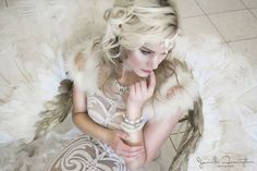 Photo Shoot at The Ashley Castle 06/14/16  Dress designed by Antoaneta Balabanova and Galina Mihaleva for Galina Couture.     Jewelry by Lana May.                                     MUA Courtney Alexa Leach.                       Hair by Leetha Ramirez Cantrell                       Wings by Alexis Noriega.                                 Model Brittany Case.                                       Photography Jamell Framp