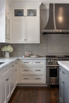 Square knobs, long chrome pulls. White cabinets. Green he or gray subway tile backsplash #whitekitchen