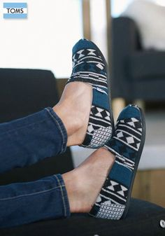 Treat your feet to the comfort and styling of these Classics slip on shoes made with a black, white and blue tribal knit upper and an ultra soft-feel shearling liner for a warm and comfortable wear.
