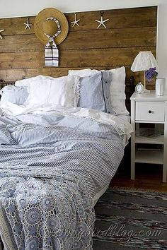 My summer bedroom with a repurposed wood headboard,  blue linens and a vintage crochet bedspread. See it on: http://Songbirdblog.com