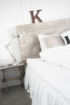 calm bedroom - reclaimed wood headboard