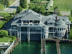Million Dollar Boathouse. The fabulous home of John Winn, owner of Four Winns Yachts, rests on the shores of Round Lake in Charlevoix, Mich. Extravagance Unlimited: The Original Million Dollar Rooms Tour Opt In, Million Dollar Rooms, Multi Million Dollar Homes, Boat Garage, Haus Am See, Waterfront Homes, Room Tour, My Dream Home, Dream Homes