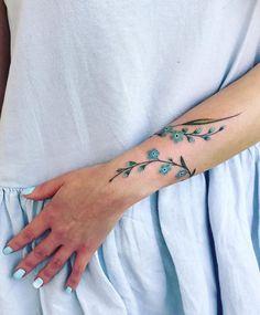 Mini Tattoos On wrist; beautiful tattoos 30 Mini Tattoos On Wrist Meaningful Wrist Tattoos Wrap Around Wrist Tattoos, Unique Wrist Tattoos, Meaningful Wrist Tattoos, Wrist Tattoos For Women, Tattoos For Women Small, Arm Wrap Tattoo, Small Colorful Tattoos, Colorful Flower Tattoo, Lotus Flower