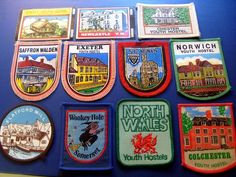 A selection of youth hostel badges