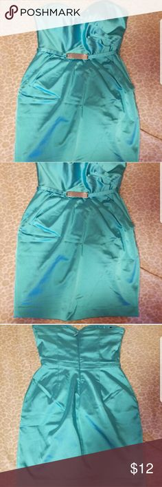 BeBe strapless mini formal dress In good condition minus the marks shown in photos above...one on left side of the bra top and marking on the lower right side. Zipper back size *S* and has pockets! Its a shiny blue color! bebe Dresses Strapless
