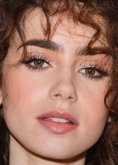 Close-up of Lily Collins at the Hollywood Foreign Press Association's 2017 Cannes event.