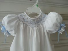"""Hand made for the United Way auction. Size  18 months.  Smocking plate is """"Priscilla's Collar and Bonnet"""" with additional rows added."""