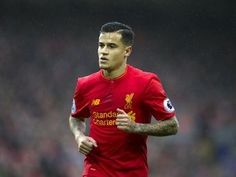 Liverpool's Philippe Coutinho forced off early after suffering injury at Watford