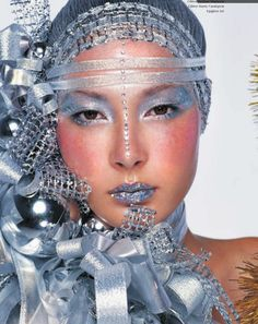 Crystals accent a make-up look that is all about silver.