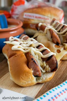 Grilled Kielbasa Rolls with White Sauce - Grilled Kielbasa smothered in sauerkraut & onions, swiss cheese and zesty white barbecue sauce - all piled into a KING'S HAWAIIAN Hot Dog Roll! Grilled Kielbasa, Grilled Sausage, White Bbq Sauce, Barbecue Sauce, Keilbasa And Sauerkraut, Polish Sausage Recipes, Polish Recipes, Brat Sausage, Hot Dogs