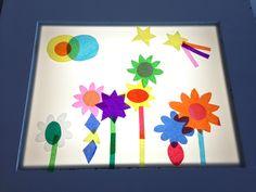 kleuren mengen en tekenen met kleuren en vormen op de lichtbak