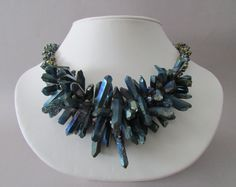 This stunning necklace has been made with peacock colored Quartz stick crystals, freshwater pearls, Chinese crystal and Miyuki beads. The cones