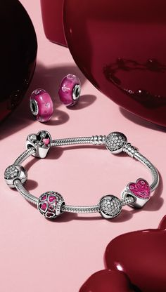 These charms in vibrant pink hues will make your heart skip a beat.  We sure can't wait to fill our PANDORA bracelet with heart-shaped tokens of love.