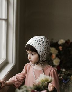 Classic simple baby girl style. Bonnet by Briar Handmade for Noble Carriage with organic cotton lining soft and safe for baby's sensitive skin. Rosa floral pattern delicate sweet baby chic. Flower child boho babe.