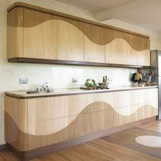 """The Wave"" concealed hardware cabinets by Designer Makers Furniture"