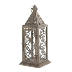You'll admire this gorgeous candle lantern day and night, with and without light. The antiqued pewter-like finish of the metal frame is high...