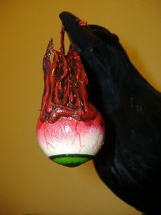Freshly Plucked Eyeball - Cheap and easy prop! Uses a foam eyeball and raven from Michaels, hot glue, paint and gloss medium.